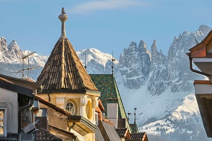 The Rosengarten massif serves as Bolzano's backdrop