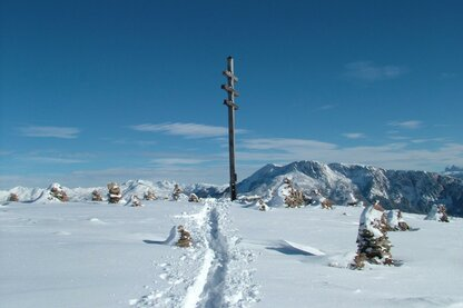 The cross atop the Möltner Joch in wintertime